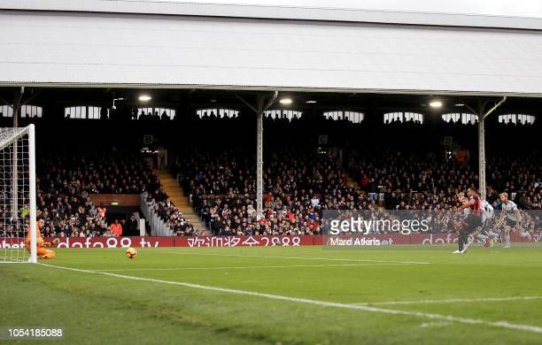 Callum Wilson of AFC Bournemouth scores a penalty for his team's first goal during the Premier League match between Fulham FC and AFC Bournemouth at...