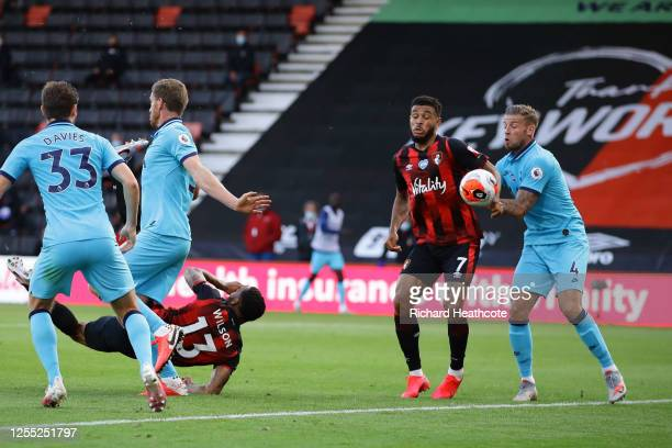 Callum Wilson of AFC Bournemouth scores but it is later disallowed as Joshua King of AFC Bournemouth handles the ball during the Premier League match...