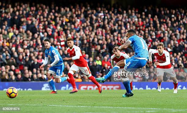 Callum Wilson of AFC Bournemouth scores his sides first goal from the penalty spot during the Premier League match between Arsenal and AFC...