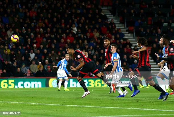Callum Wilson of AFC Bournemouth scores his team's first goal during the Premier League match between AFC Bournemouth and Huddersfield Town at...
