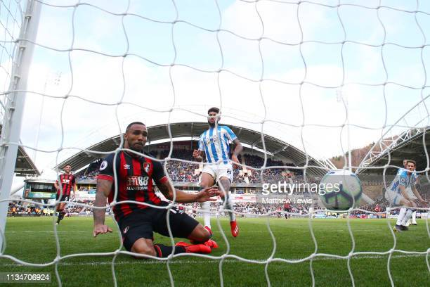 Callum Wilson of AFC Bournemouth scores his team's first goal during the Premier League match between Huddersfield Town and AFC Bournemouth at John...