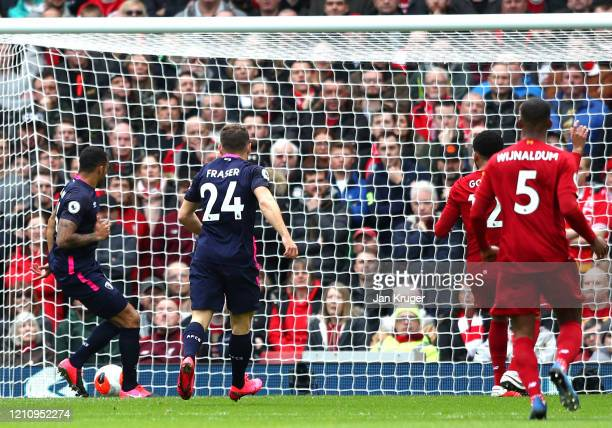 Callum Wilson of AFC Bournemouth scores his team's first goal during the Premier League match between Liverpool FC and AFC Bournemouth at Anfield on...