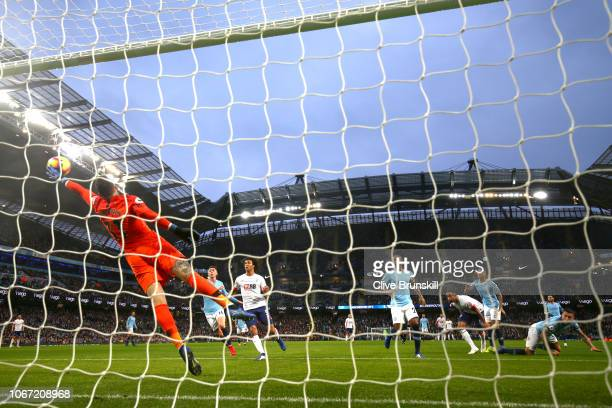 Callum Wilson of AFC Bournemouth scores his team's first goal past Ederson of Manchester City during the Premier League match between Manchester City...
