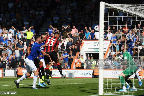Callum Wilson of AFC Bournemouth scores his team's first goal past Jordan Pickford of Everton during the Premier League match between AFC Bournemouth...