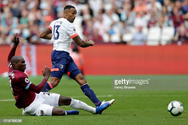 Callum Wilson of AFC Bournemouth shoots and scores his side's first goal during the Premier League match between West Ham United and AFC Bournemouth...