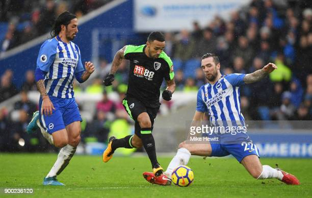 Callum Wilson of AFC Bournemouth takes on Matias Ezequiel Schelotto and Shane Duffy of Brighton and Hove Albion during the Premier League match...