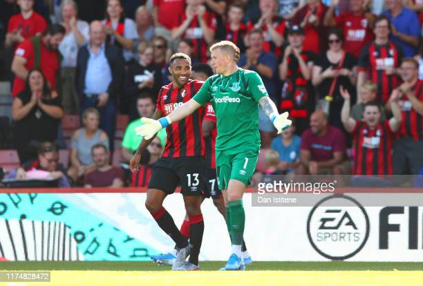 Callum Wilson of AFC Bournemouth talks to Jordan Pickford of Everton as he scores his team's third goal during the Premier League match between AFC...