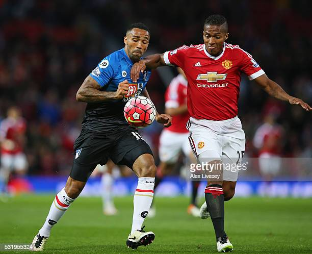 Callum Wilson of Bournemouth and Antonio Valencia of Manchester United battle for the ball during the Barclays Premier League match between...