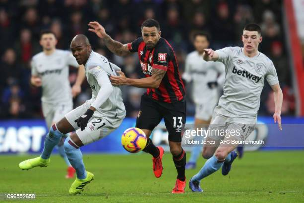 Callum Wilson of Bournemouth and gets between Angelo Ogbonna and Declan Rice of West Ham United during the Premier League match between AFC...
