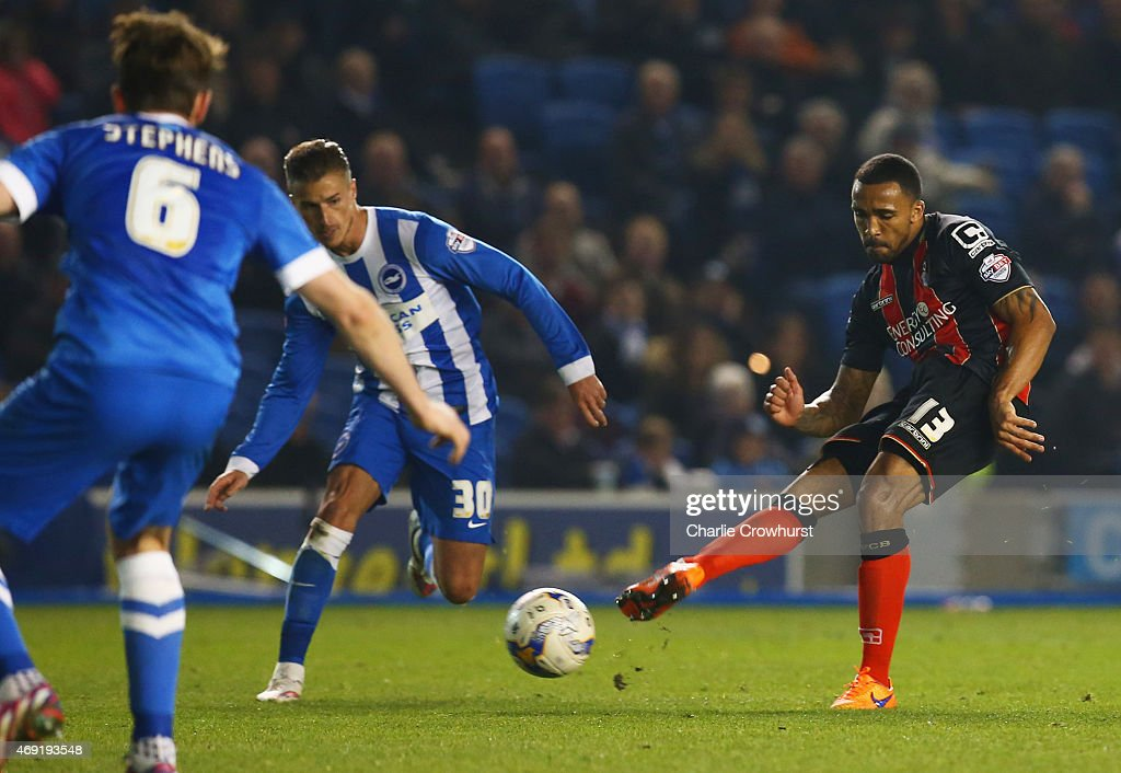 Callum Wilson of Bournemouth (R) beats the Brighton defence to score their second goal during the Sky Bet Championship match between Brighton & Hove Albion and AFC Bournemouth at Amex Stadium on April 10, 2015 in Brighton, England.