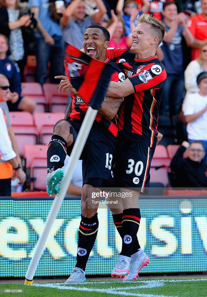 Callum Wilson (L) of Bournemouth celebrates scoring his team's first goal with his team mate Matt Ritchie (R) during the Barclays Premier League match between A.F.C. Bournemouth and Sunderland at Vitality Stadium on September 19, 2015 in Bournemouth, United Kingdom.