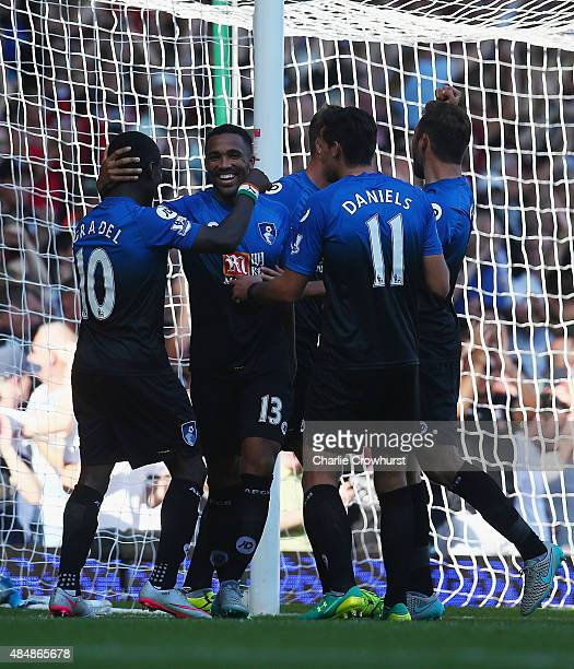 Callum Wilson of Bournemouth celebrates scoring his team's fourth goal from the penalty spot to make a hat trick with his team mates during the...