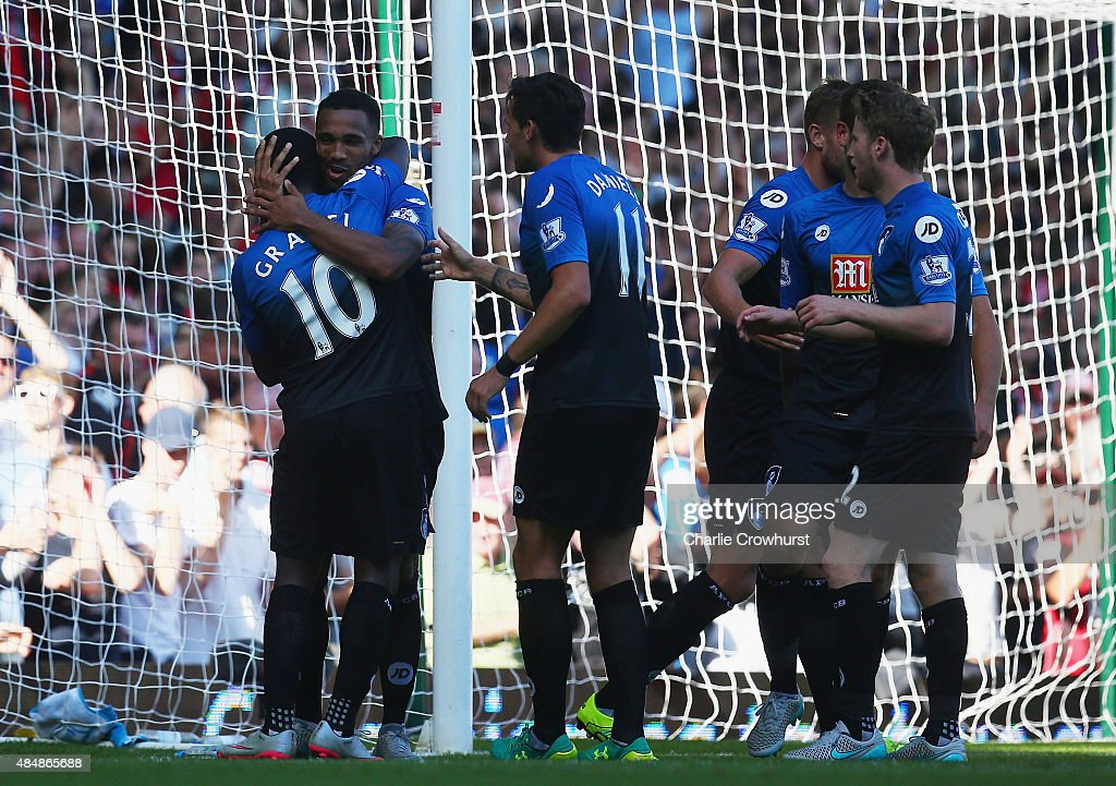 Callum Wilson (2nd L) of Bournemouth celebrates scoring his team's fourth goal from the penalty spot to make a hat trick with his team mates during the Barclays Premier League match between West Ham United and A.F.C. Bournemouth at the Boleyn Ground on August 22, 2015 in London, England.