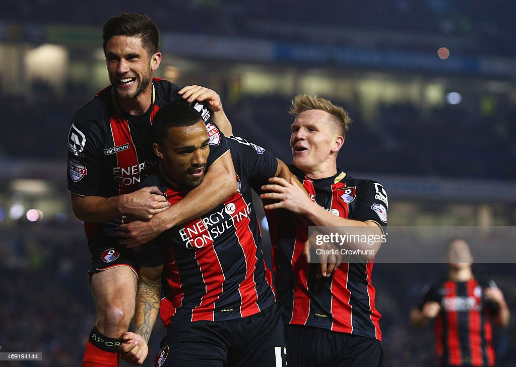 Callum Wilson of Bournemouth (2L) celebrates with Andrew Surman (L) and Matt Ritchie (3L) as he scores their second goal during the Sky Bet Championship match between Brighton & Hove Albion and AFC Bournemouth at Amex Stadium on April 10, 2015 in Brighton, England.