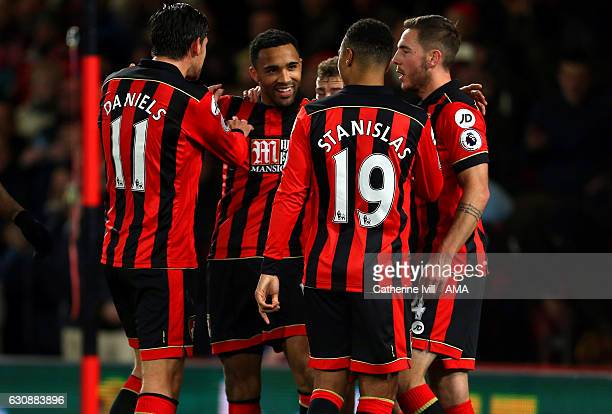 Callum Wilson of Bournemouth celebrates with his team mates after he scores a goal to make it 20 during the Premier League match between AFC...