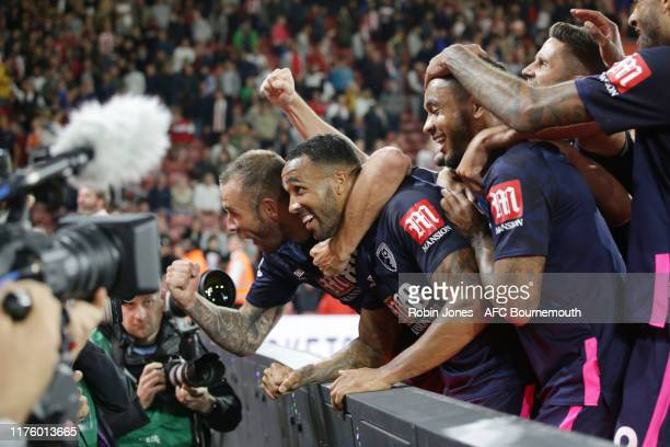 Callum Wilson of Bournemouth celebrates with teammate Steve Cook and Joshua King after he scores a goal to make it 31 during the Premier League match...