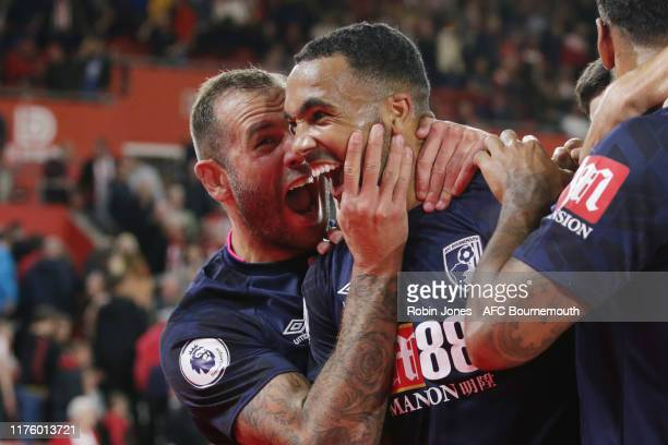 Callum Wilson of Bournemouth celebrates with team-mate Steve Cook after he scores a goal to make it 3-1 during the Premier League match between...