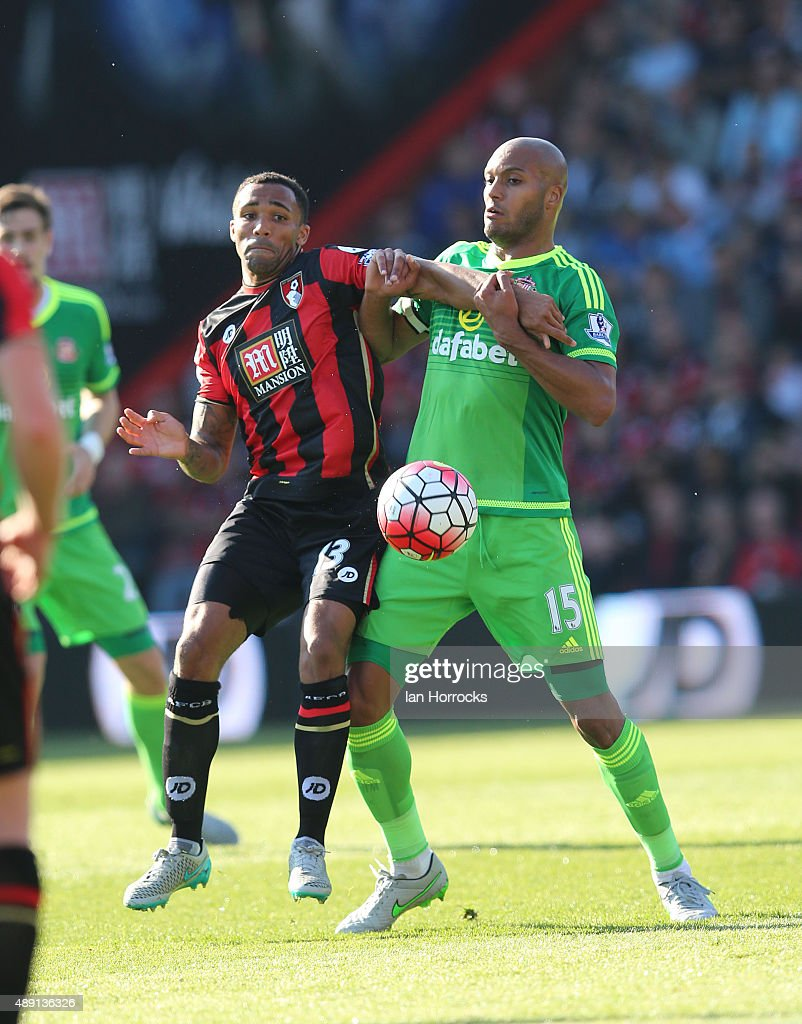 Callum Wilson of Bournemouth (L) challenges Younes Kaboul of Sunderland during the Barclays Premier League match between Bournemouth and Sunderland at the Vitality Stadium on September 19, 2015 in Bournemouth, England.