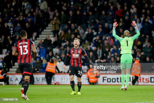 Callum Wilson of Bournemouth congratulates teammate Ryan Fraser after he makes it 20 during the Premier League match between AFC Bournemouth and...