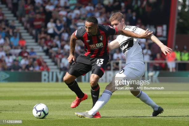 Callum Wilson of Bournemouth holds off Maxime Le Marchand of Fulham during the Premier League match between AFC Bournemouth and Fulham FC at Vitality...