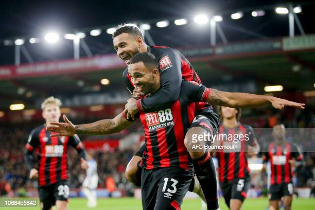 Callum Wilson of Bournemouth is and is congratulated by teammate Joshua King after he scores a goal to make it 10 during the Premier League match...
