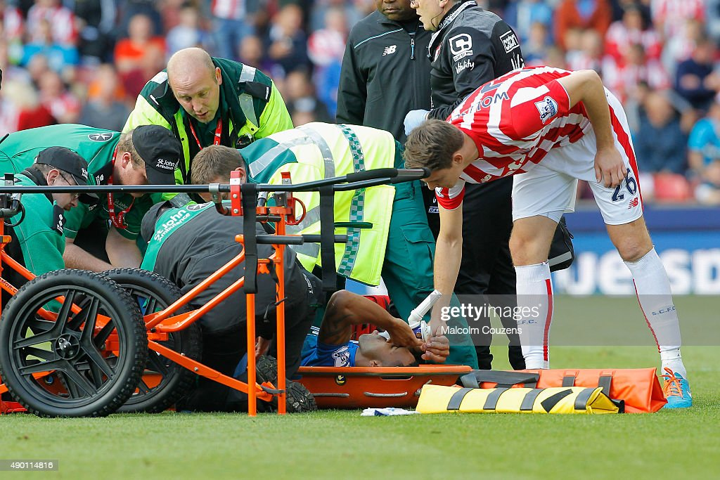 Callum Wilson of Bournemouth is taken by a stretcher after his injury during the Barclays Premier League match between Stoke City and A.F.C. Bournemouth at Britannia Stadium on September 26, 2015 in Stoke on Trent, United Kingdom.