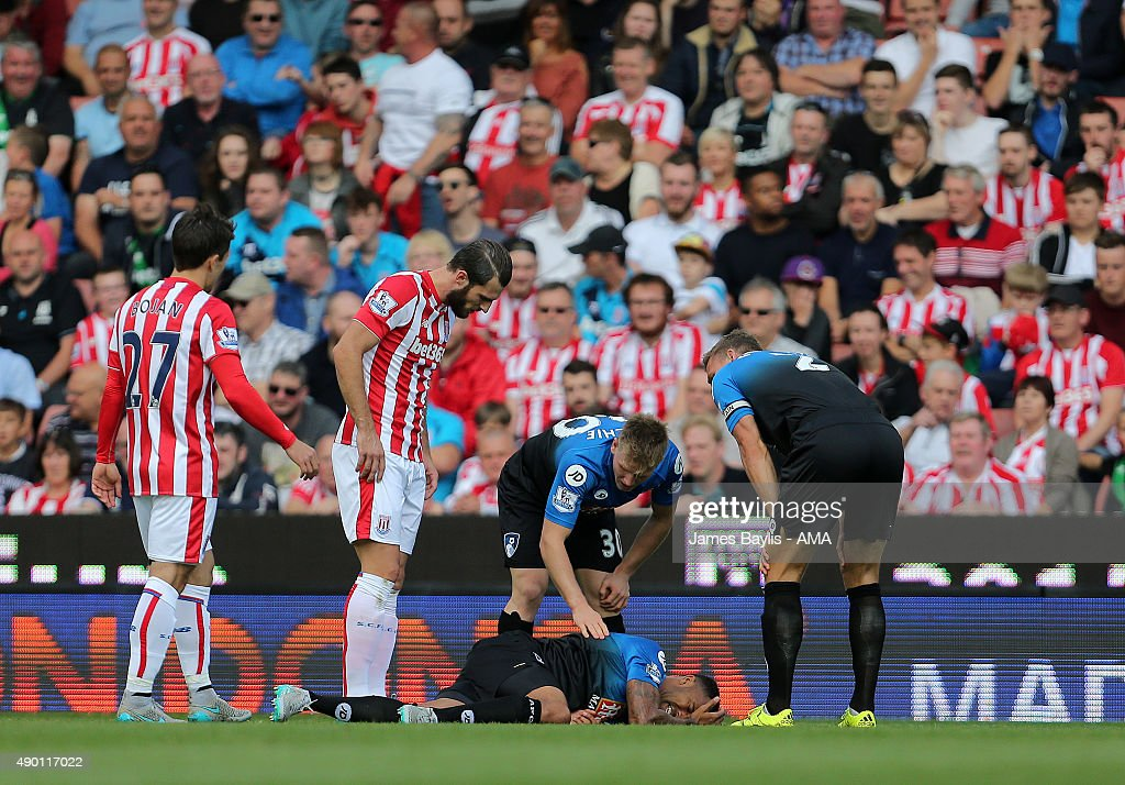 Callum Wilson of Bournemouth lies injured on the ground during the Barclays Premier League match between Stoke City and Bournemouth on September 26, 2015 in Stoke on Trent, United Kingdom.
