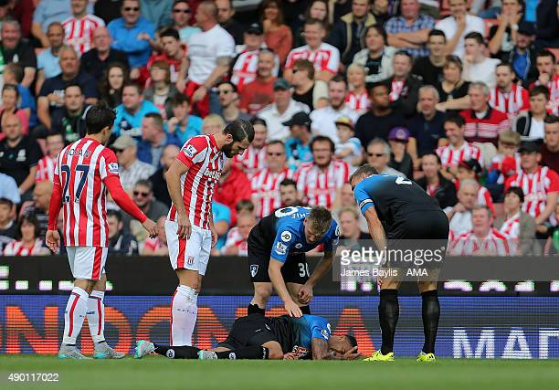 Callum Wilson of Bournemouth lies injured on the ground during the Barclays Premier League match between Stoke City and Bournemouth on September 26...