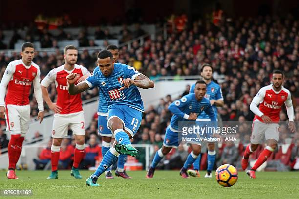 Callum Wilson of Bournemouth scores his side's first goal from a penalty to make the score 11 during the Premier League match between Arsenal and AFC...