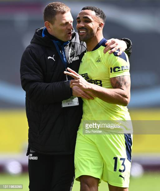 Callum Wilson of Newcastle shares a joke with assistant coach Graeme Jones after the Premier League match between Burnley and Newcastle United at...