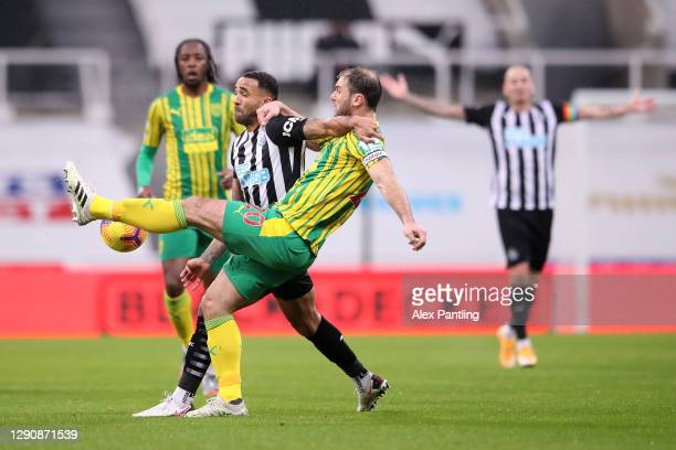 Callum Wilson of Newcastle United and Branislav Ivanovic of West Bromwich Albion battle for the ball during the Premier League match between...
