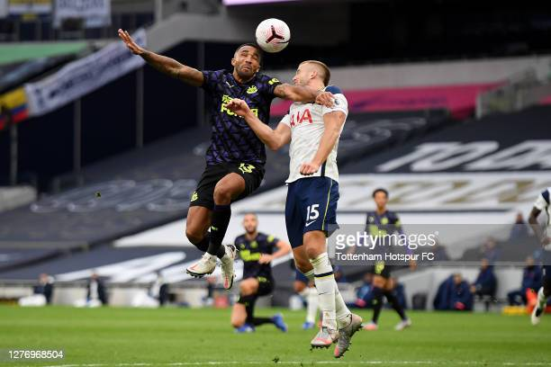 Callum Wilson of Newcastle United and Eric Dier of Tottenham Hotspur compete for a header during the Premier League match between Tottenham Hotspur...
