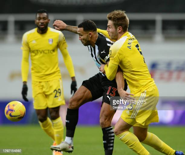 Callum Wilson of Newcastle United and Joachim Andersen of Fulham FC jostle for the ball during the Premier League match between Newcastle United and...
