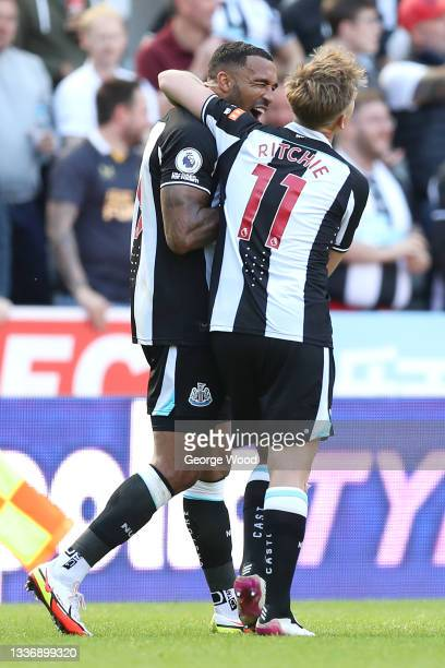 Callum Wilson of Newcastle United celebrates after scoring their sides first goal with team mate Matt Ritchie during the Premier League match between...
