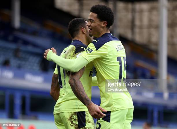 Callum Wilson of Newcastle United celebrates with team mate Jamal Lewis after scoring his team's second goal during the Premier League match between...