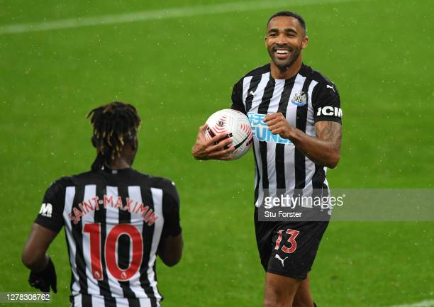 Callum Wilson of Newcastle United celebrates with teammate Allan Saint-Maximin after scoring his team's second goal during the Premier League match...