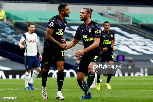 Callum Wilson of Newcastle United celebrates with teammate Andy Carroll after scoring his sides first goal during the Premier League match between...
