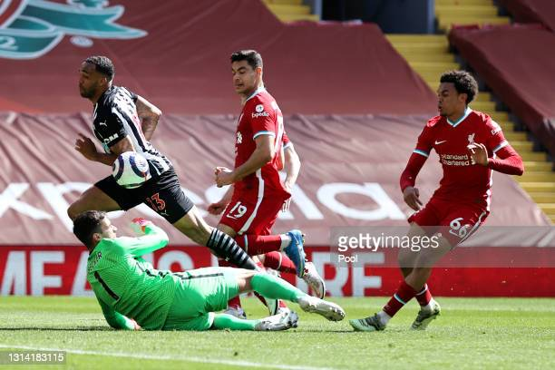 Callum Wilson of Newcastle United rounds Alisson of Liverpool to score a goal which is later ruled out for handball during the Premier League match...