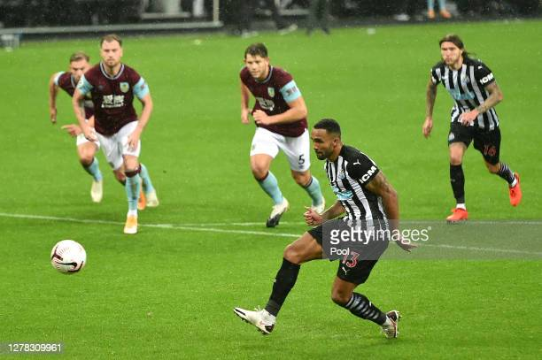 Callum Wilson of Newcastle United scores a penalty for his team's third goal during the Premier League match between Newcastle United and Burnley at...
