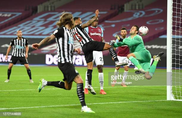 Callum Wilson of Newcastle United scores his team's first goal past Lukasz Fabianski of West Ham United during the Premier League match between West...