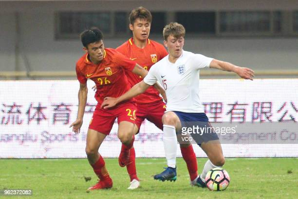 Callum Wright of England U19 National Team and Chen Ao of China U19 National Team compete for the ball during the 2018 Panda Cup International Youth...
