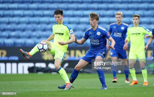 Callum Wright of Leicester City in action with Alex Babos of Derby County during the Premier League 2 match between Leicester City and Derby County...