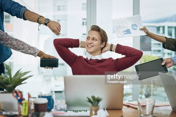 calm amongst the chaos - delegating stock photos and pictures