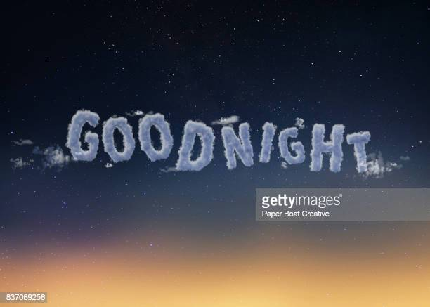 calm and sound execution of the word good night with a dark and gloomy sky as a background - typographies stock photos and pictures