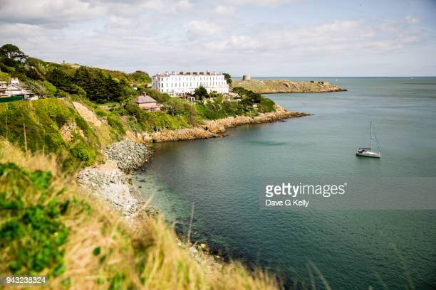 calm bay with clear water and anchored sailboat, ireland - irish sea stock pictures, royalty-free photos & images