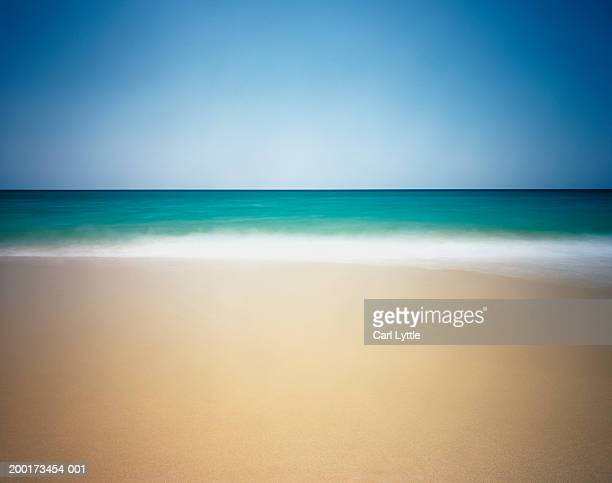 Calm beach under blue sky