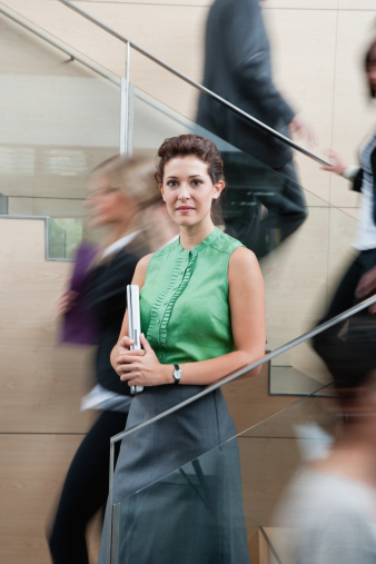 Calm businesswoman in staircase - gettyimageskorea
