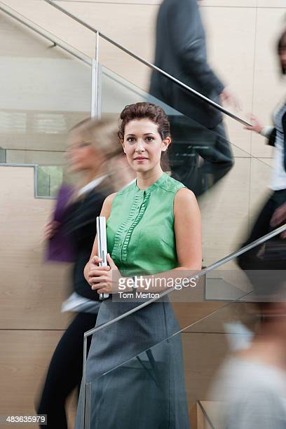 calm businesswoman in staircase - 20 29 years stock pictures, royalty-free photos & images