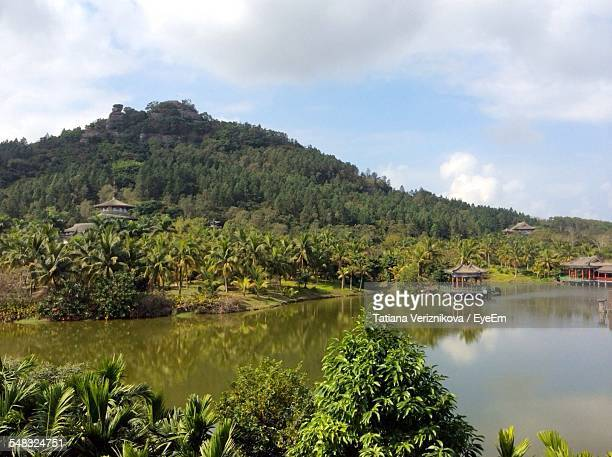 calm countryside lake against the sky - hainan island stock pictures, royalty-free photos & images