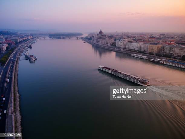 calm danube river in an early morning - fluss stock-fotos und bilder